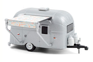 AIRSTREAM BAMBI WITH PEACE AND LOVE AWNING 1961